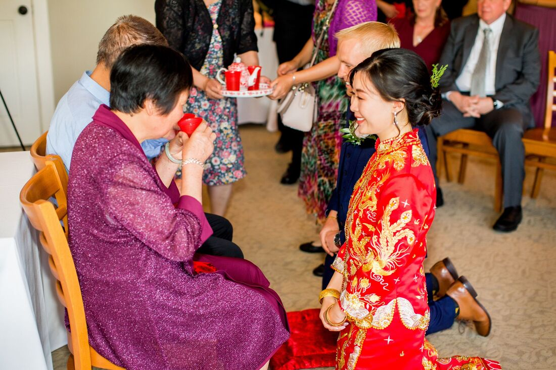 bride and groom at tea ceremony